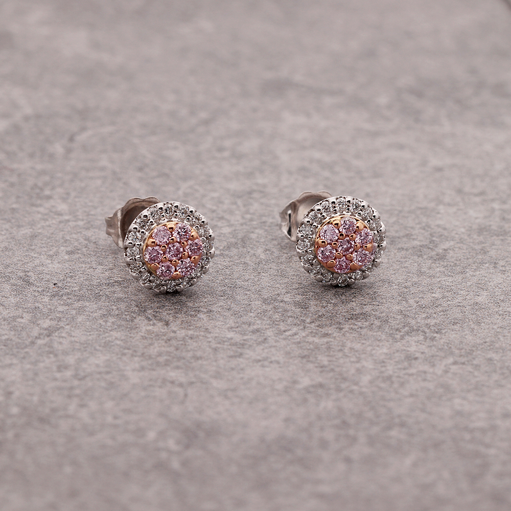 Pink diamond cluster earrings.