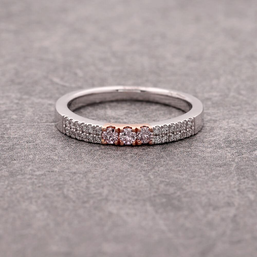 Three stone pink diamond ring.